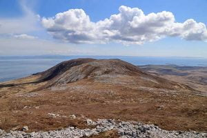 View over the Beinn Bheigeir ridge from the top with Northern Ireland on the horizon