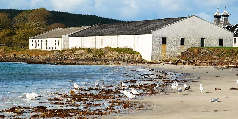 Iconic Port Ellen Warehouses and Kilns at the end of White Hart Beach